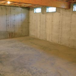 A cleaned out basement in Somerville, shown before remodeling has begun