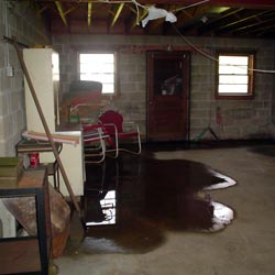 A flooded basement showing groundwater intrusion in Lowell