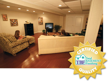 A remodeled basement with the Total Basement Finishing™ badge in Massachusetts & New Hampshire